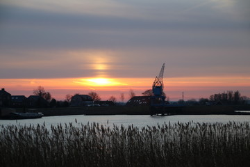 Sunrise over the river Hollandse IJssel in village Nieuwerkerk aan den IJssel