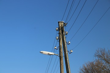small wooden poles with electricity lines and street lights in Gouderak