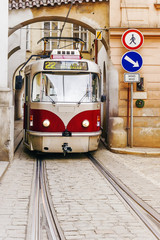 old red tram in the old streets of Prague