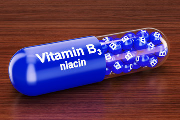Vitamin capsule B3 on the wooden table. 3D rendering