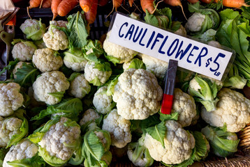 Cauliflower for sale at a farmers market.