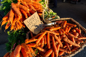 Carrots for sale at a farmers market in the morning.