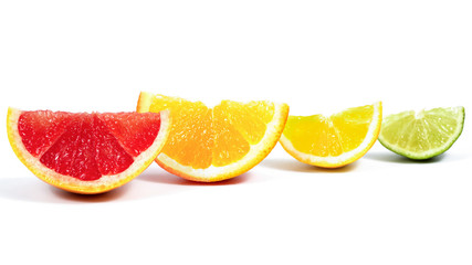 slices of orange, greatfruit, kiwi, lemon, lime on white background