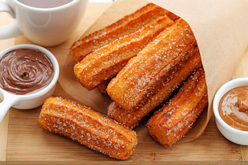 Churros with sugar and chocolate sauce . top view