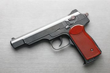 Pistol on a grey background
