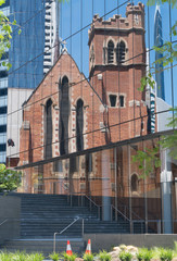 Beautiful reflection of old St. Georges Cathedral in the front of a modern office building, Perth, Western Australia