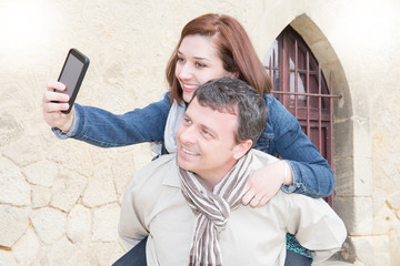 Beautiful couple making a selfie in the city tourism in France