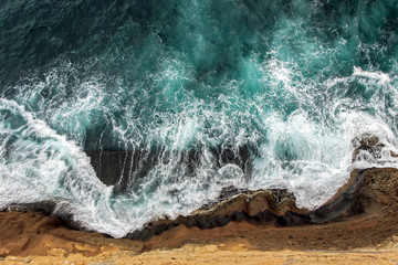 aerial view of ocean waves on cliff  Wall mural