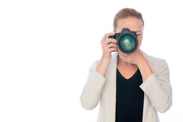 Woman photographer takeing images with dslr camera isolated on white background.