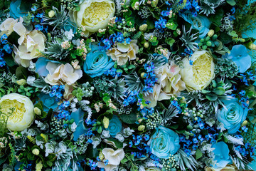 Colorful floral background of blue roses and other flowers