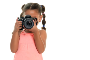 Small multiracial girl taking pictures with a professional camera