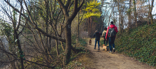 Family with dog hiking at mountain trail