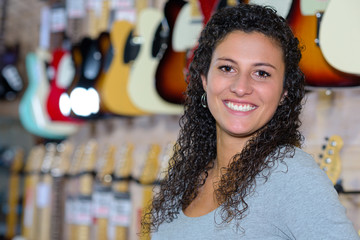Portrait of woman in music shop