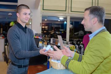 man buying fresh eggs