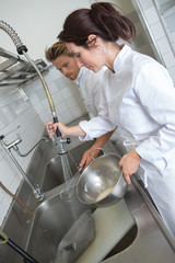 cleaning dishware kitchen sink
