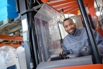 Portrait of man in forklift truck