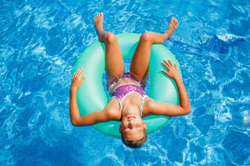 Beautiful girl relax in pool