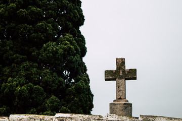 Ancient religious cross on a cloudy day.