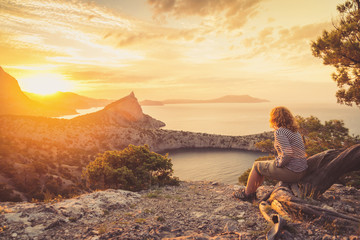 Girl tourist admiring the beautiful sunset