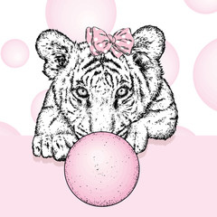 A beautiful tiger with a bow on his head. Cute tiger cub. Vector illustration for a postcard or a poster, print for clothes and accessories.