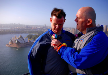 Warren Orlandi and Pauly Phillips talk after they became the first same-sex couple to marry atop of the Sydney Harbour Bridge, just two days out from the 40th anniversary of the Sydney Gay and Lesbian Mardi Gras