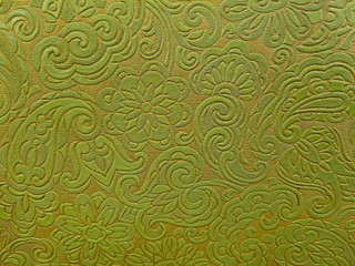 close up of retro olive green and gold vinyl abstract pattern