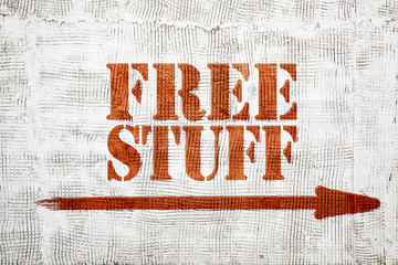 free stuff-  graffiti on stucco wall