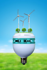 Wind turbines and trees in bulb. Saving lamp. Green energy theme.