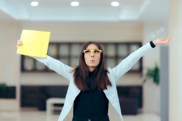 Excited Business Women Holding Up Important Documents