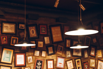 lamp in cafe room blurred pictures on the wall