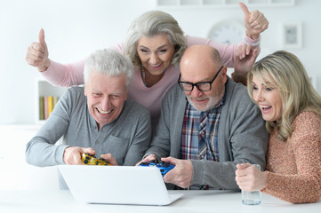 senior couples playing computer game