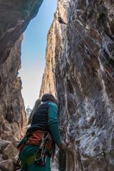 Woman belays climber on a rock, bottom view, Turkey, Chitdibi