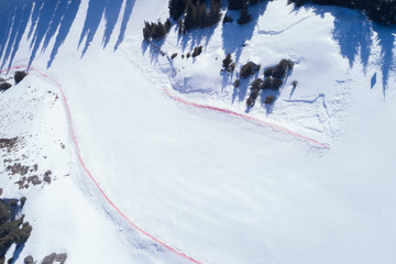 Aerial view of the Alpine skiing and snowboarding piste in mountains