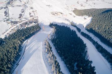 Aerial view of the Alpine skiing and snowboarding resort in mountains
