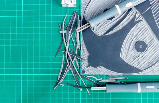 Lino cutting tools on a desktop.