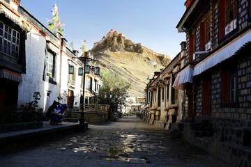 narrow street in the Tibetan city of temples