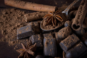 Black Chocolate, Spices, Tea Spoon, Cocoa, Cinnamon on Wooden Background