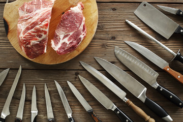 various kitchen knives and meat