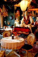 Retro restaurant interior decorated with tradicional horse carriage