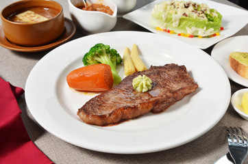 New York Steak served with salad and soup