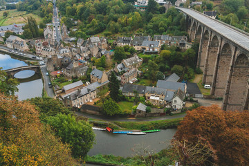 Aerial view of Vallee de la Rance with old bridge Le Vieux Pont and 40 meter high viaduct over river Rance in medieval town of Dinan, Brittany, France