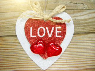 valentine's day love holiday concept hearts on old wooden background
