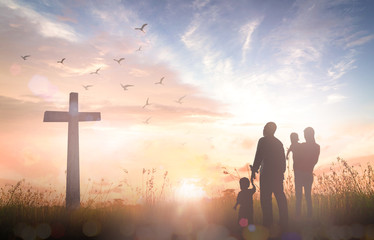 Ascension day concept: Silhouette people looking for the cross on autumn sunrise background
