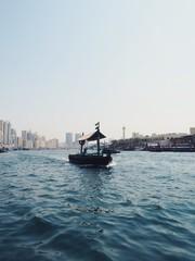 Traditional boat (abra) sailing on the Dubai Creek