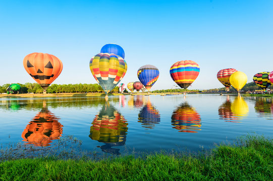 Group of colourful balloons on the lake