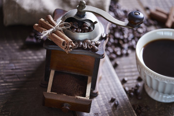 Close up of coffee grinder with ground coffee