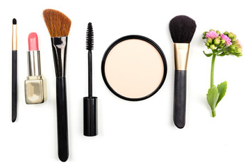 Makeup accessories, shot from above, with copy space on white