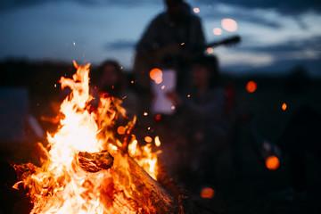 Tuinposter Kamperen Spark Flying from beach bonfire in summer