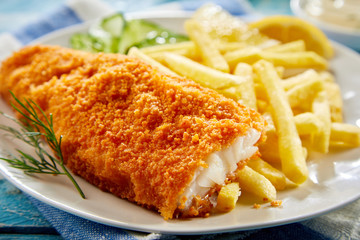 Portion of crispy fish with french fries