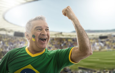 Senior Brazilian man fan celebrating